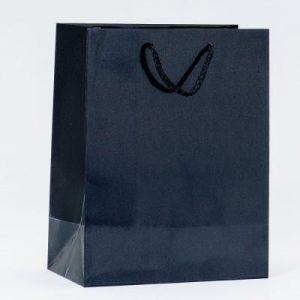idee-cadeau-client-sac-cadeau-pellicule-noir-luxe